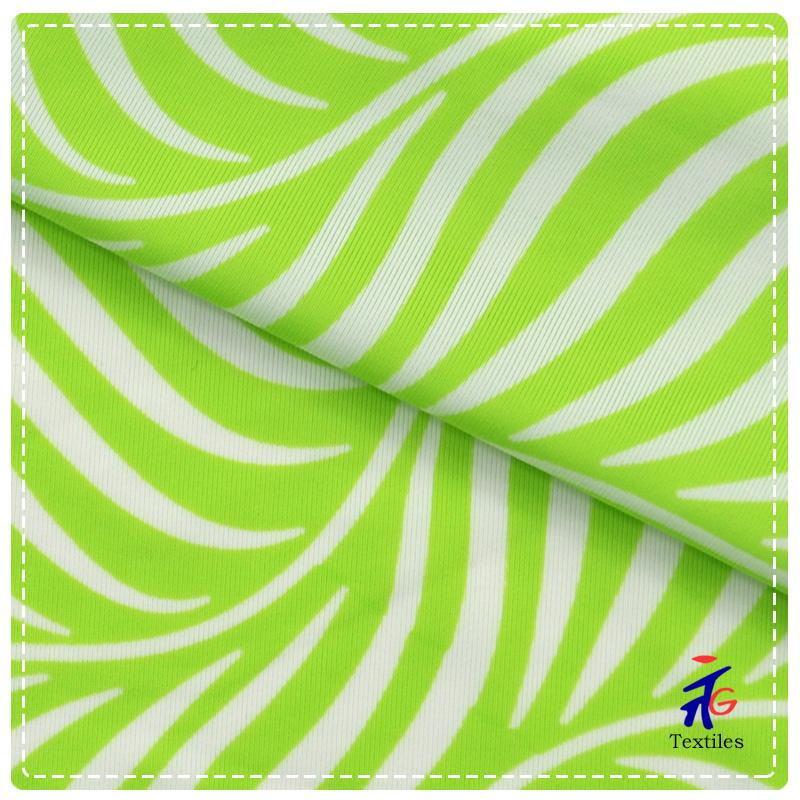 bright green and white zebra design knitted fabric